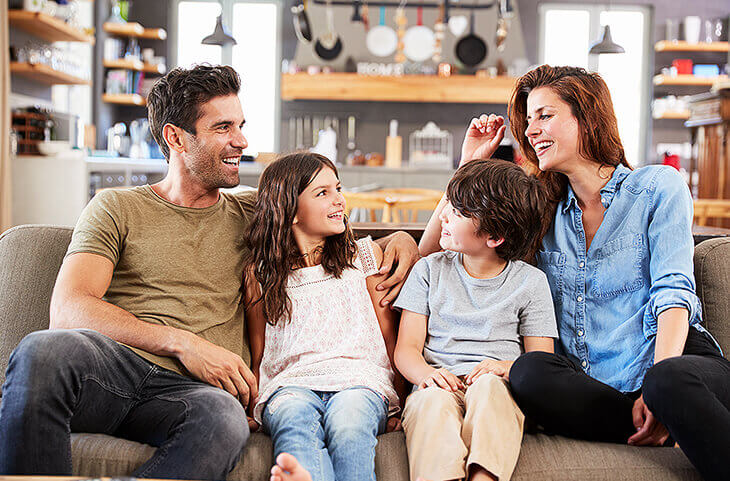 couple with kids on couch